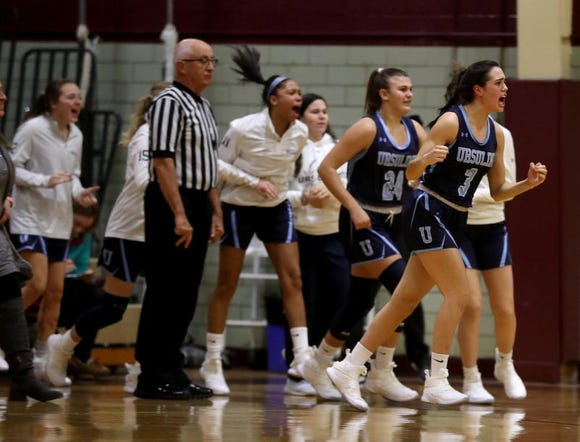 Ursuline players cheer as their team made a run during a varsity basketball game at Ossining High School Jan. 25, 2019. Ossining defeated Ursuline 77-64.