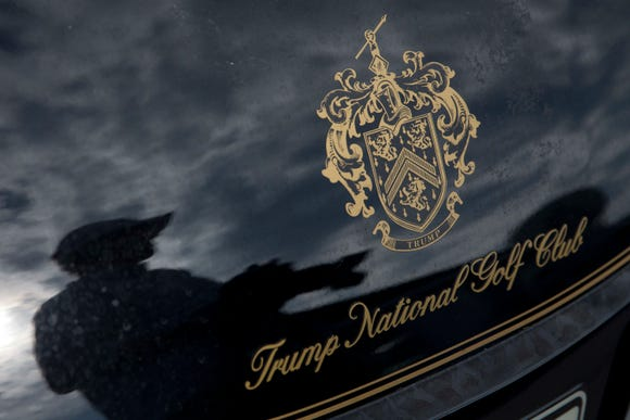 FILE - In this Tuesday, June 7, 2016 file photo, a photographer reflected in a golf cart at the the Trump National Golf Club Westchester in Briarcliff Manor, N.Y. A lawyer for a dozen workers at the club who are in the United States illegally says they were fired on Jan. 18, 2019, even though managers knew of their illegal status years earlier. (AP Photo/Mary Altaffer)