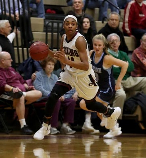 Aubrey Griffin of Ossining handles the ball against Ursuline during a varsity basketball game at Ossining High School Jan. 25, 2019. Ossining defeated Ursuline 77-64.