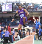 University at Albany's Robert Blue, from Harrison, competes in the triple jump in the Dr. Sander Invitational at the Armory Track & Field Center in New York on Saturday, January 26, 2019.