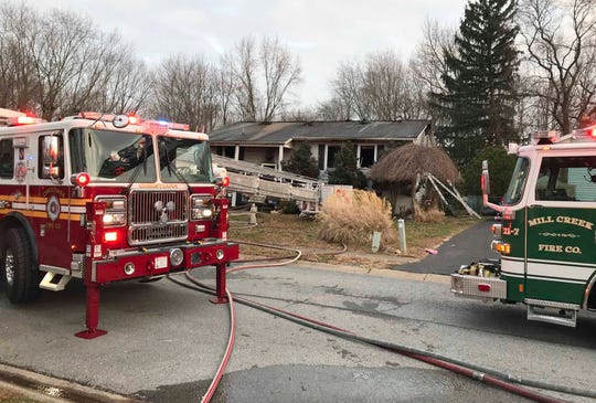 Firefighters work after extinguishing a blaze in a home on Oakfield Drive in the Scottfield development near Newark, reported about 4:15 pm Saturday.