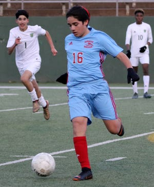 Hirschi's Bryan Camacho dribbles in the match against Benbrook Friday, Jan. 25, 2019, at Memorial Stadium. The Huskies fell to Benbrook 3-2.