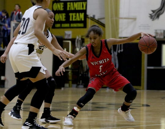 Wichita Falls High School's Dre'nea Singleton dribbles in the game against Rider Friday.