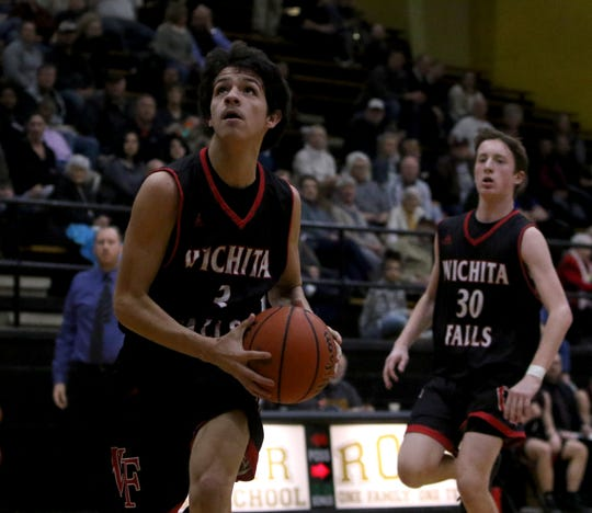Wichita Falls High School's Austin Dishman looks to the basket in the game against Rider Friday, Jan. 25, 2019, at Rider.