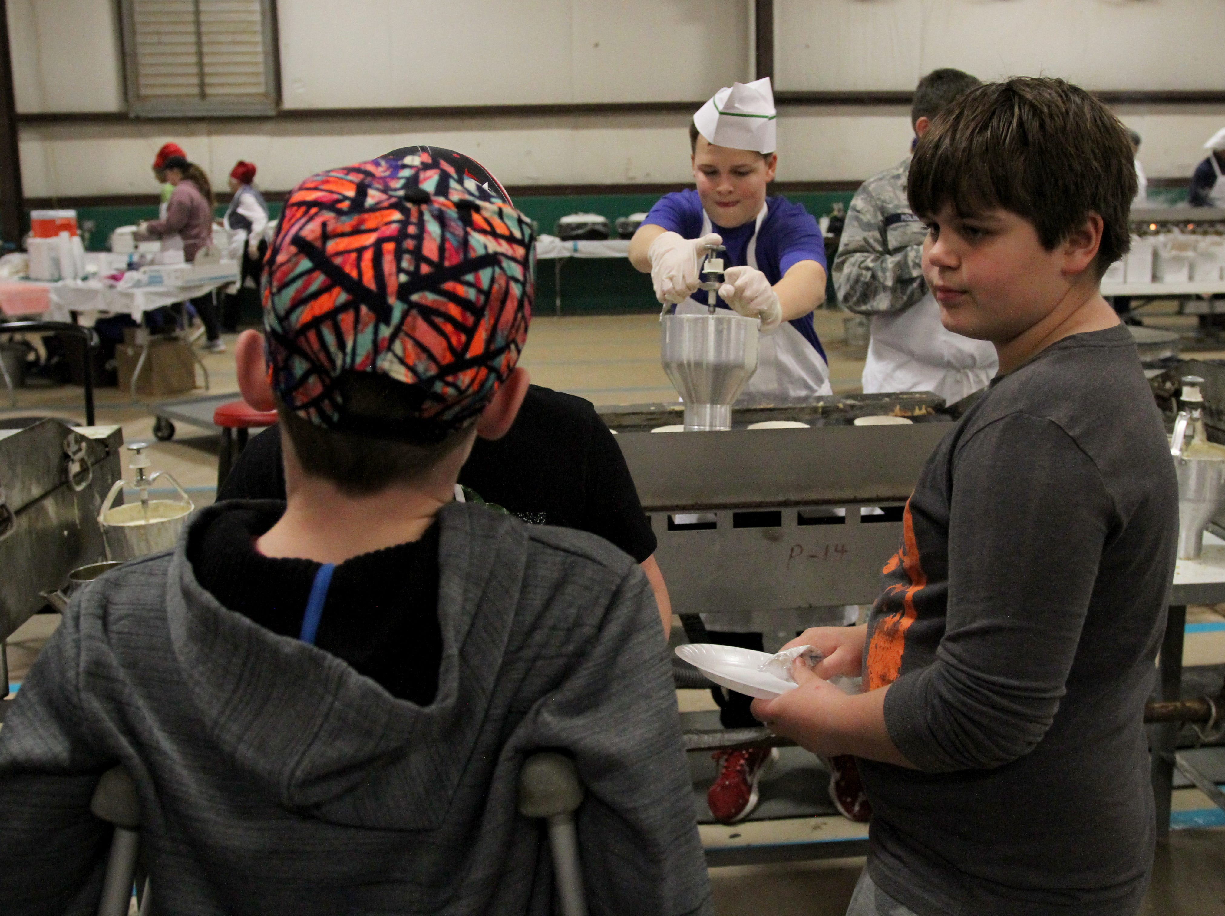 Generations of families volunteered for the 63rd University Kiwanis Club Pancake Festival Saturday, Jan. 26, 2019, at the J.S. Bridwell Agricultural Center.