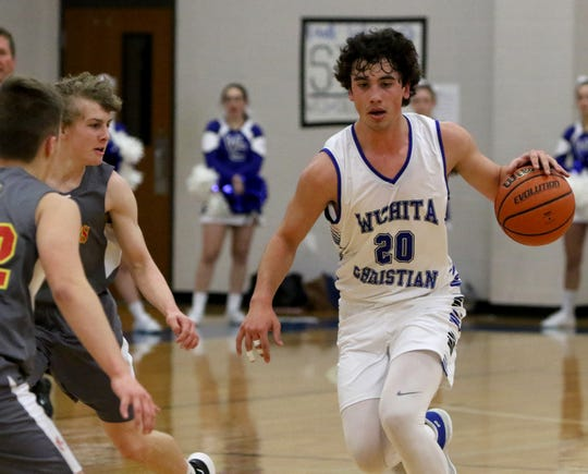 Wichita Christian's Evan Findley dribbles in the game against Christ Academy Friday, Jan. 25, 2019, at Wichita Christian.
