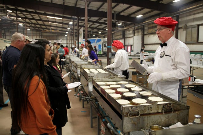 In this photo from 2019, thousands of people attend the 63rd University Kiwanis Club Pancake Festival at the J.S. Bridwell Agricultural Center. This year's 64th annual feed will be Saturday, Jan. 25 from 6 a.m. to 6 p.m.