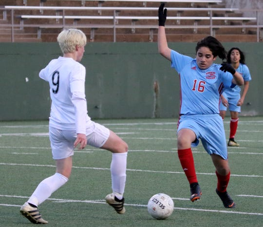Hirschi's Bryan Camacho (16) goes for the ball as Benbrook's Dalton Smith passes Friday, Jan. 25, 2019, at Memorial Stadium. The Huskies fell to Benbrook 3-2.