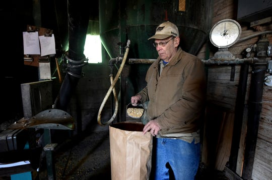 """""""Feed mills and steel yards are always the coldest place in the winter. They both soak up the cold,"""" said Jim Houle as he checks the weight while bagging up feed at Houle's Feed Mill in Forest Lake, Minn. on Thursday, Jan. 10, 2019. For 103 years, the business has been selling feed and chickens and horse equipment. Now, the owners of the family-owned business, who are all in their 70s, are ready to retire."""