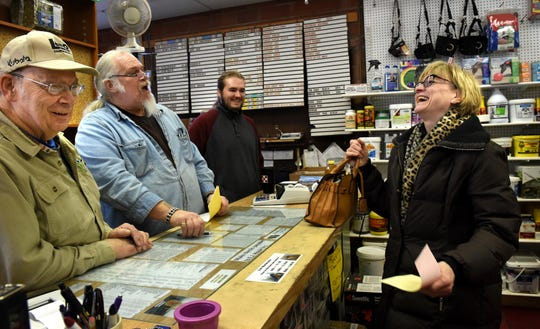 """Karla Wiessner laughs with, from left to right, James Houle, Ron Chester and Alexander Brand at Houle's Feed Mill in Forest Lake, Minn. on Thursday, Jan. 10, 2019. """"That's the part that's gonna be missed -- the interaction with customers. You don't get that at a big box store,"""" said Houle. The business, started as a feed mill by E.J. Houle in 1916, is for sale. A development company wants to buy Houle's and replace it with a 100-room hotel and convention center."""