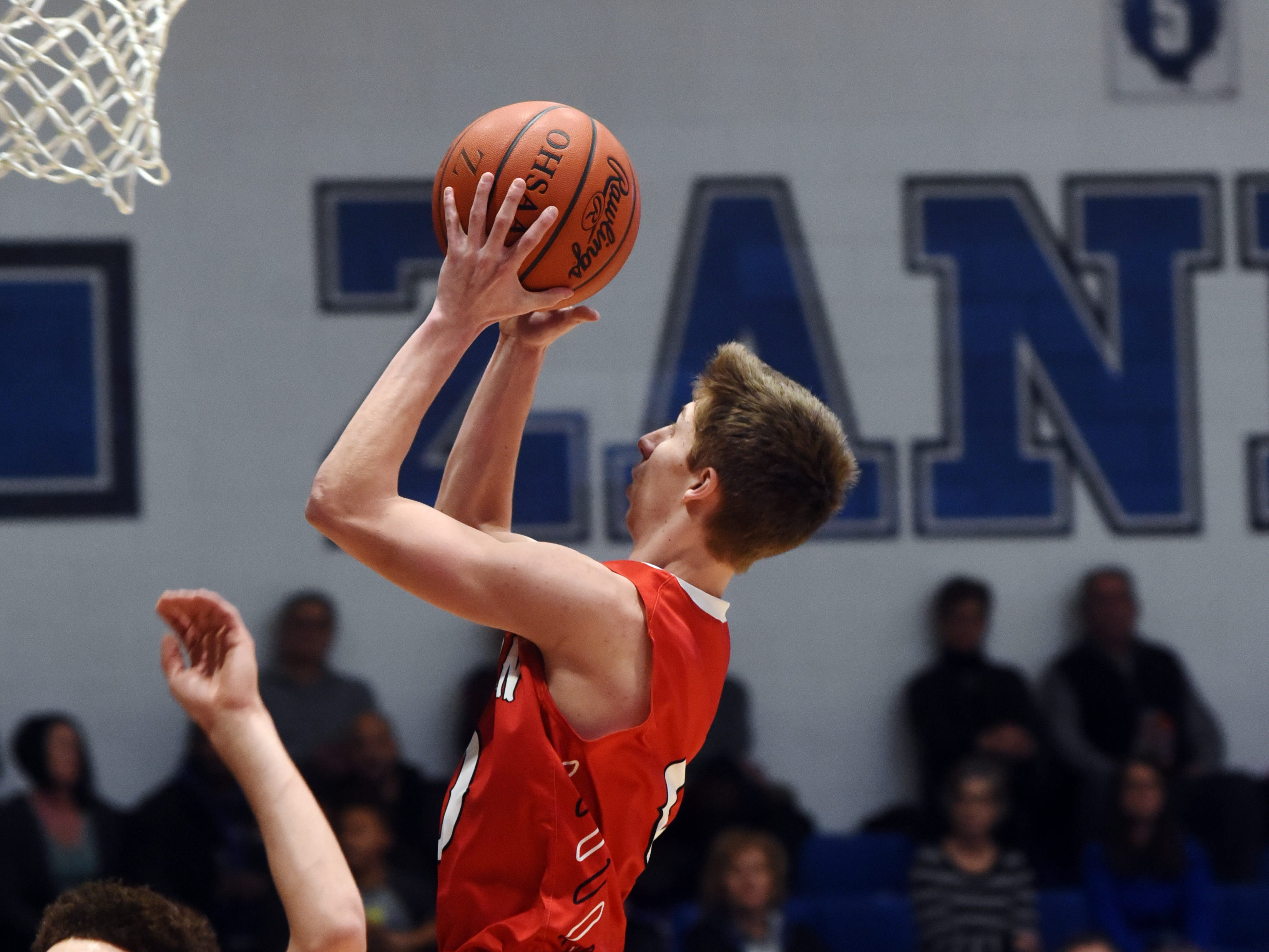 Coshocton's Gaven Williams goes up in the lane against Zanesville.