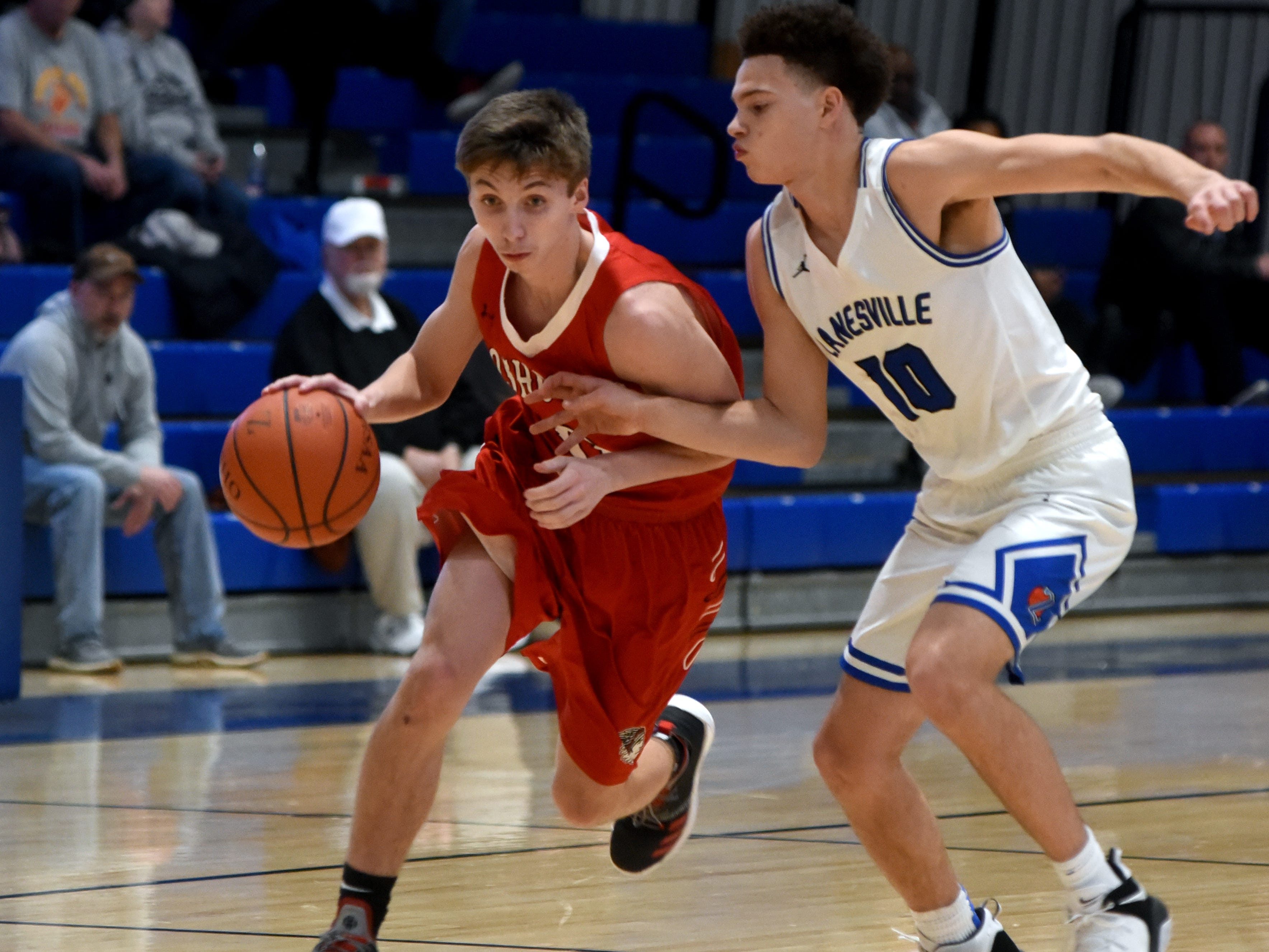 Gaven Williams, of Coshocton, drives up court against Zanesville's Kaleb Young.