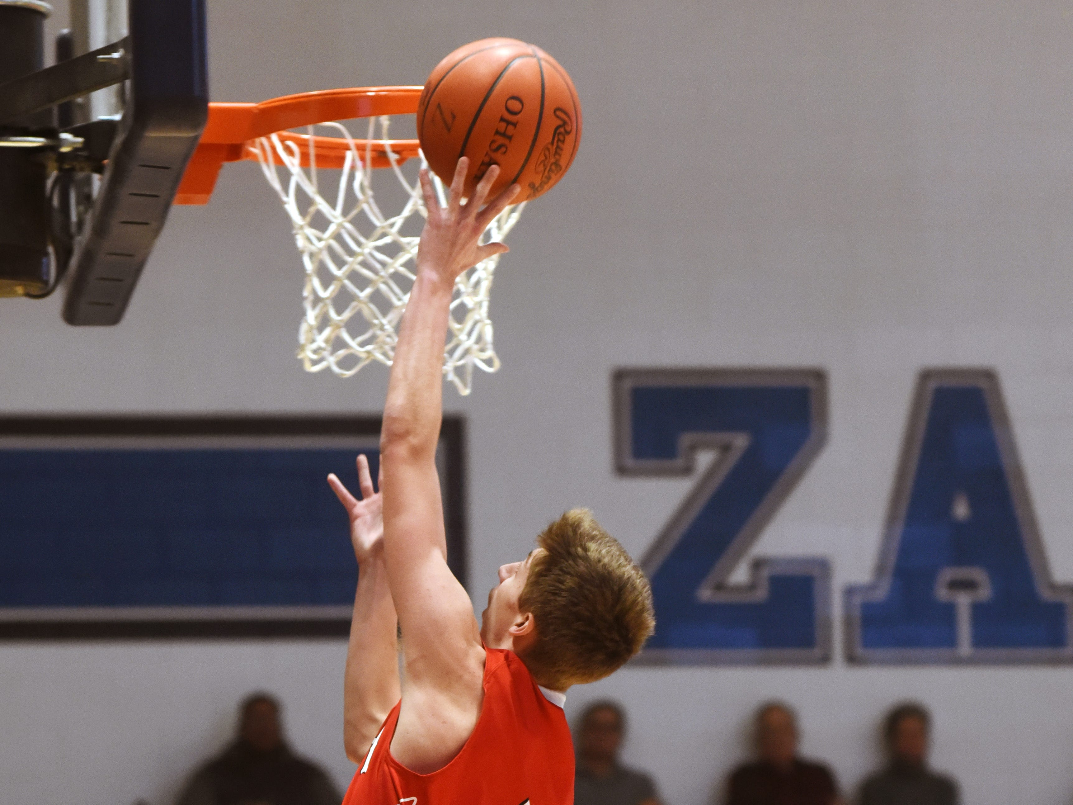 Gaven Williams, of Coshocton, goes in for a layup against Zanesville.