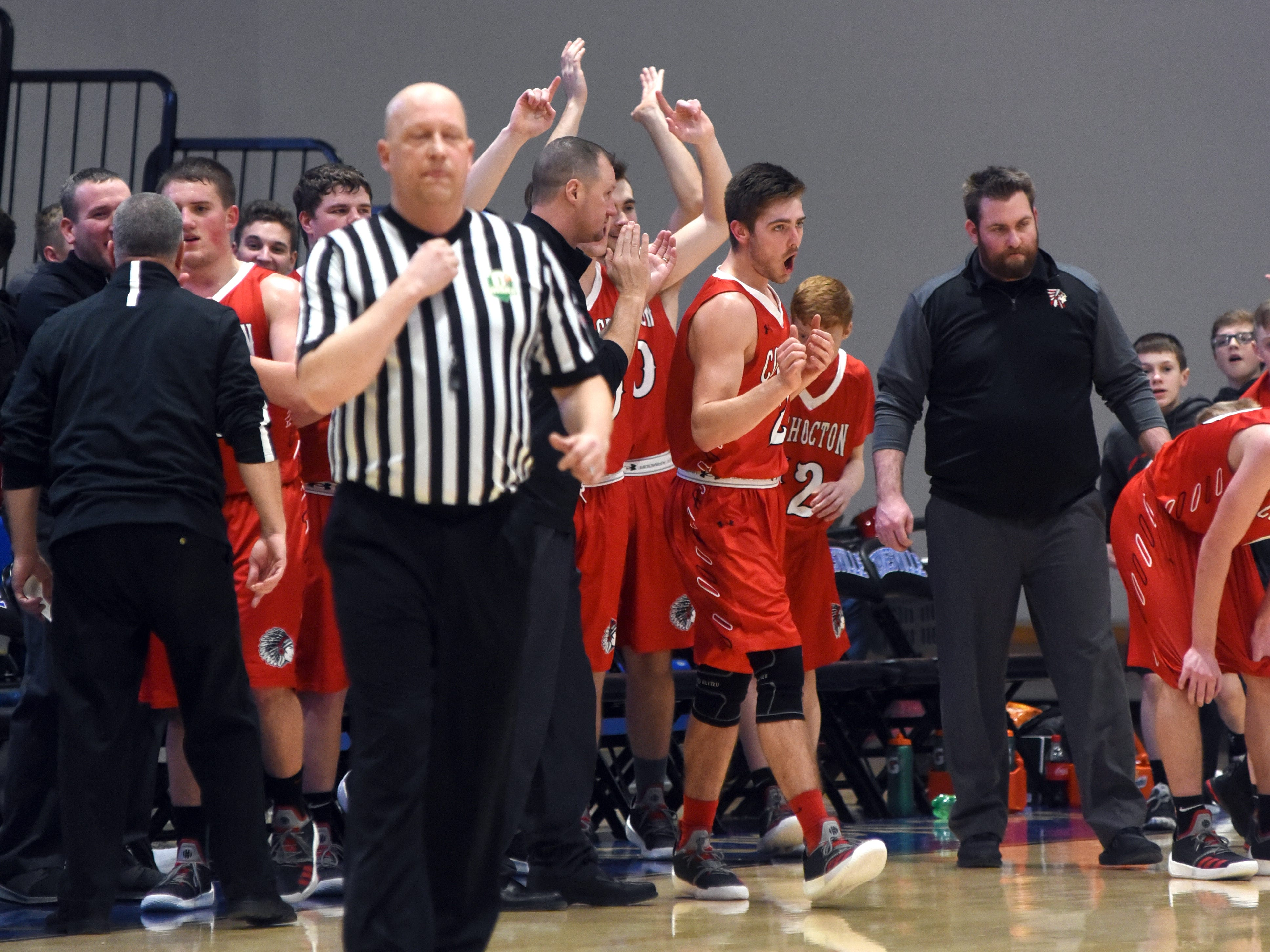 Coshocton's bench cheers following a 38-27 win against Zanesville.