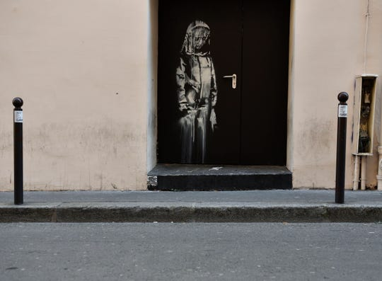 A recent artwork believed to be attributed to Banksy is of a woman veiled in mourning next to the Bataclan concert venue in Paris, France in  June 2018. According to reports on 26 January, Banksy's mural located on the door to Bataclan concert hall, where 90 people have been killed in a terror attack in 2015, has been stolen.
