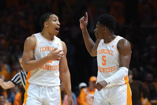 Tennessee forward Grant Williams (2) and guard Admiral Schofield talked things out against West Virginia.