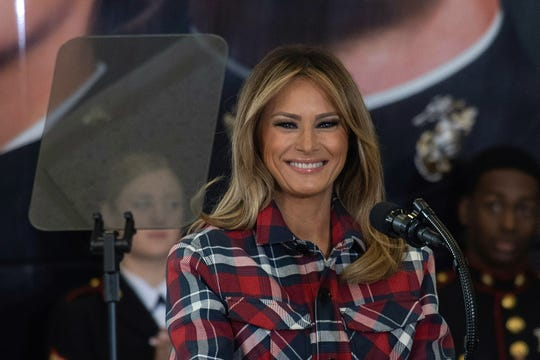 First lady Melania Trump speaks at a Tots event at Nacostia Bolling Base in Washington, DC, on December 11, 2018. -