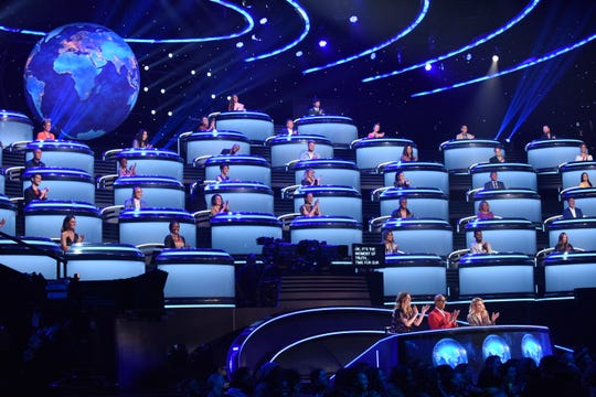 The Wall of the World, a six-level structure for international experts behind judges Faith Hill, foreground left, RuPaul Charles and Drew Barrymore, is one of the innovations of CBS's 'The World's Best.'