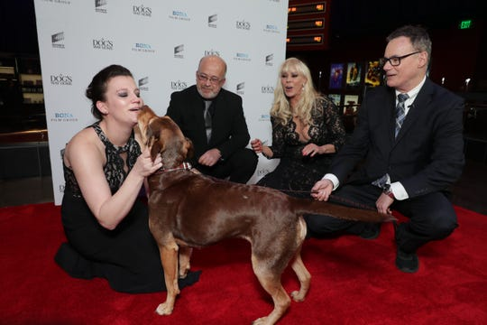"Shelby gives loving to Megan Buhler, the animal control officer who found her at a special screening of ""A Dog's Way Home. "" (L-R) Thomas ""T.J."" Jordi, Cathryn Michon and Bruce Cameron"