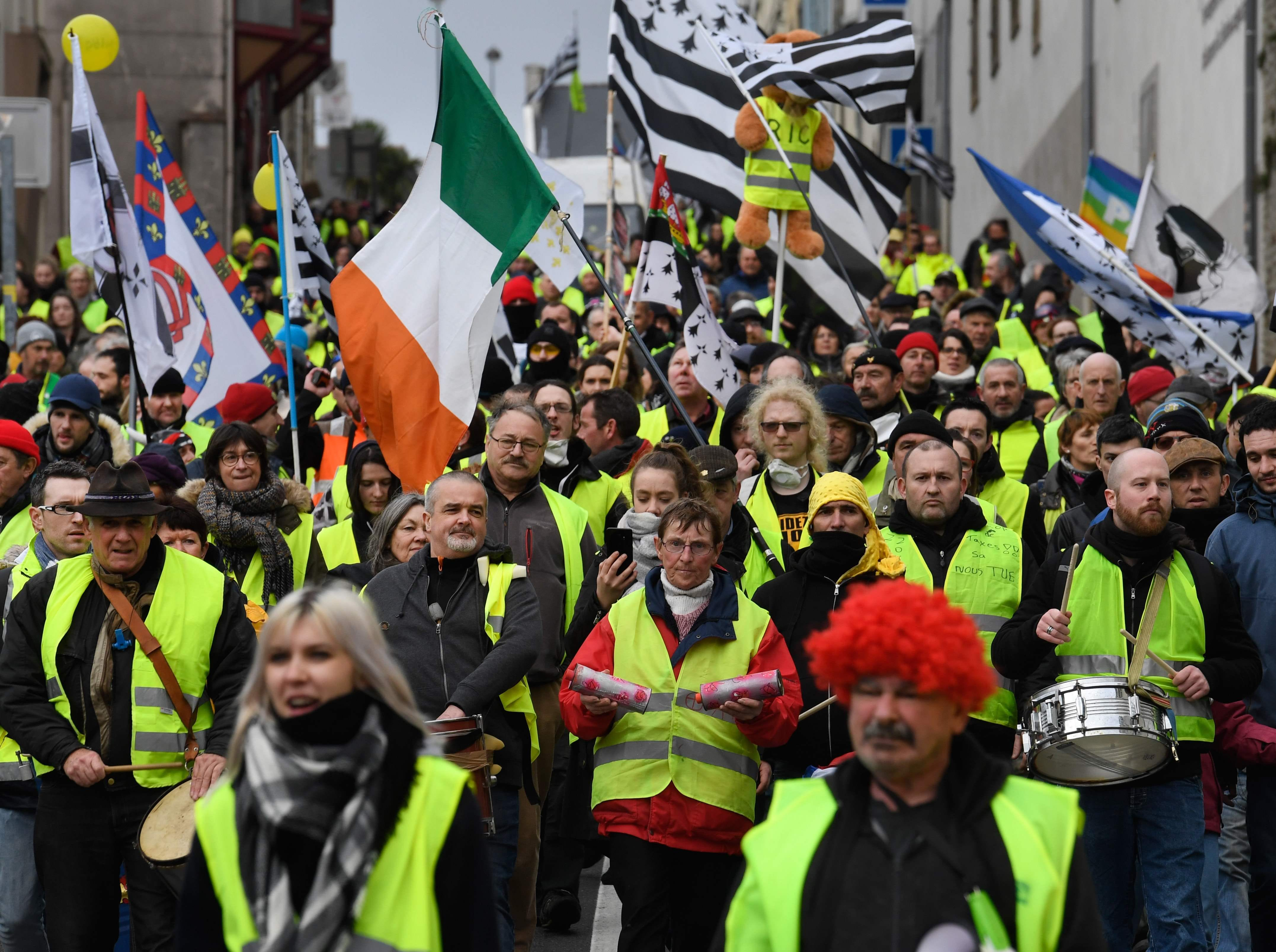 "Protestors march during an anti-government demonstration called by the Yellow Vests ""Gilets Jaunes"" movement on Jan. 26, 2019 in Quimper, western France."