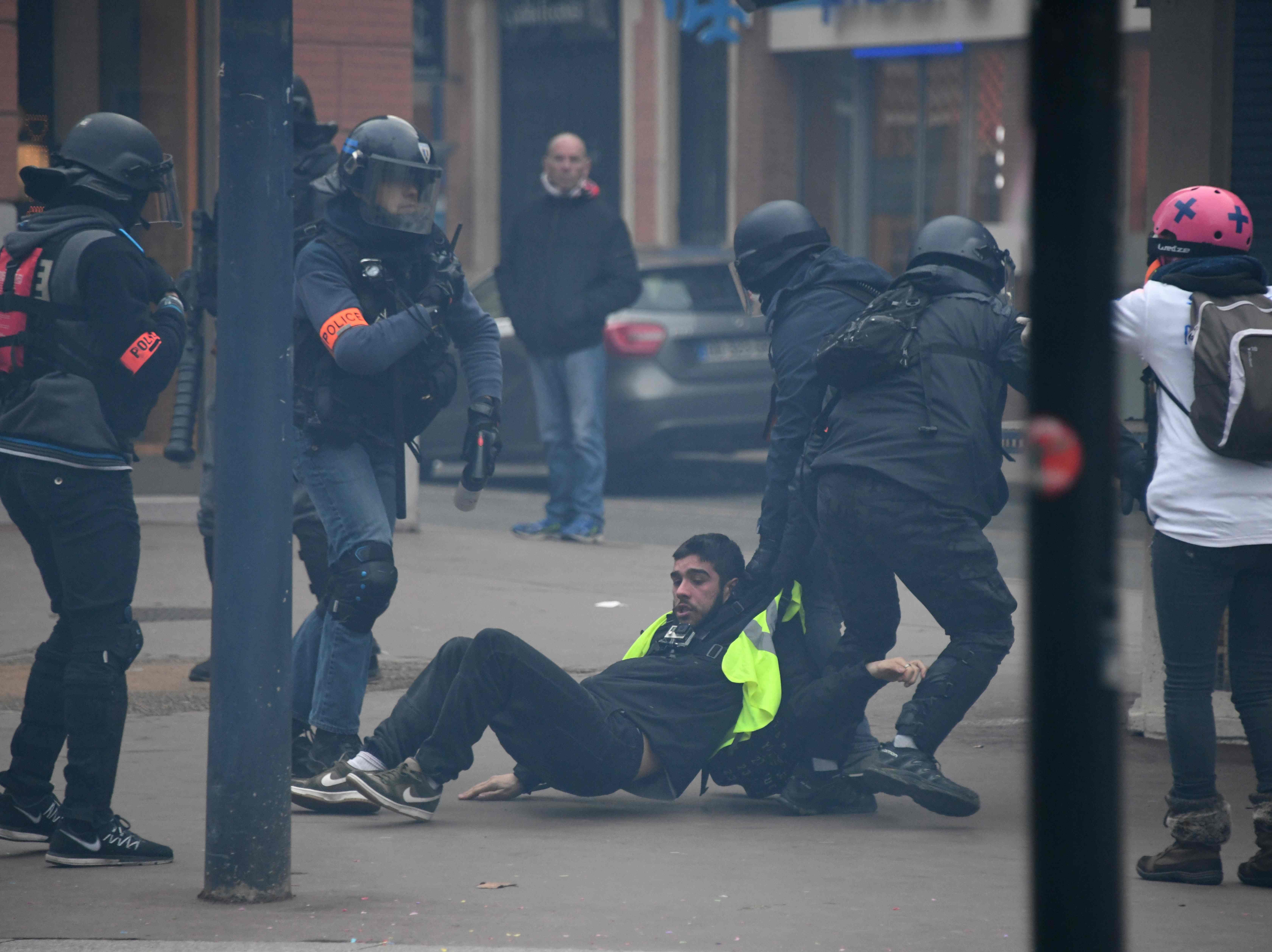 "Plain cloths police officers arrest a protester during an anti-government demonstration called by the Yellow Vests ""Gilets Jaunes"" movement in Toulouse on Jan. 26, 2019."