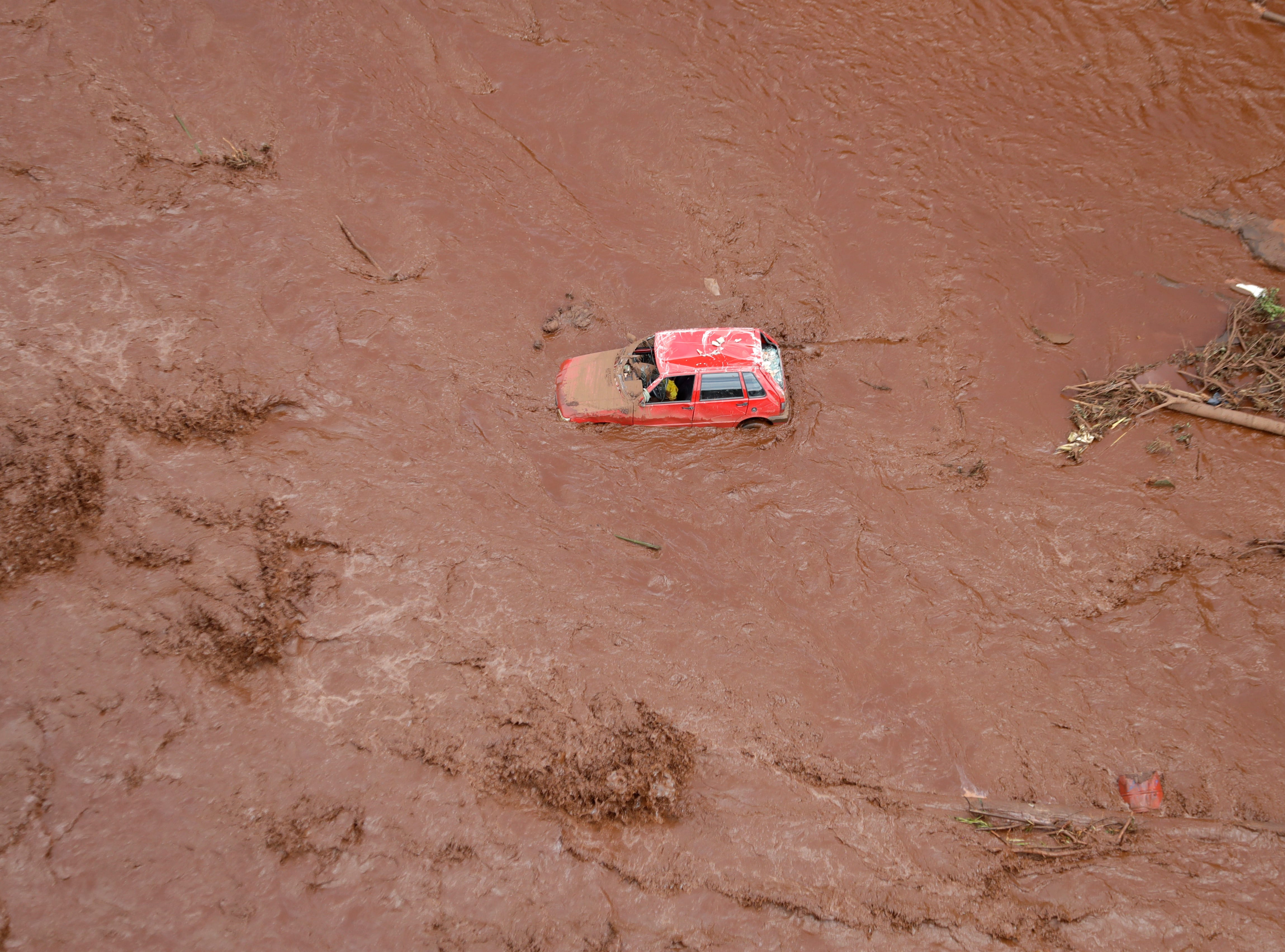 An aerial view shows a destroyed vehicle after a dam collapsed in Brumadinho, Brazil, Saturday, Jan. 26, 2019. Rescuers searched for survivors in a huge area in southeastern Brazil buried by mud from the collapse of dam holding back mine waste, with several people dead and hundreds missing.