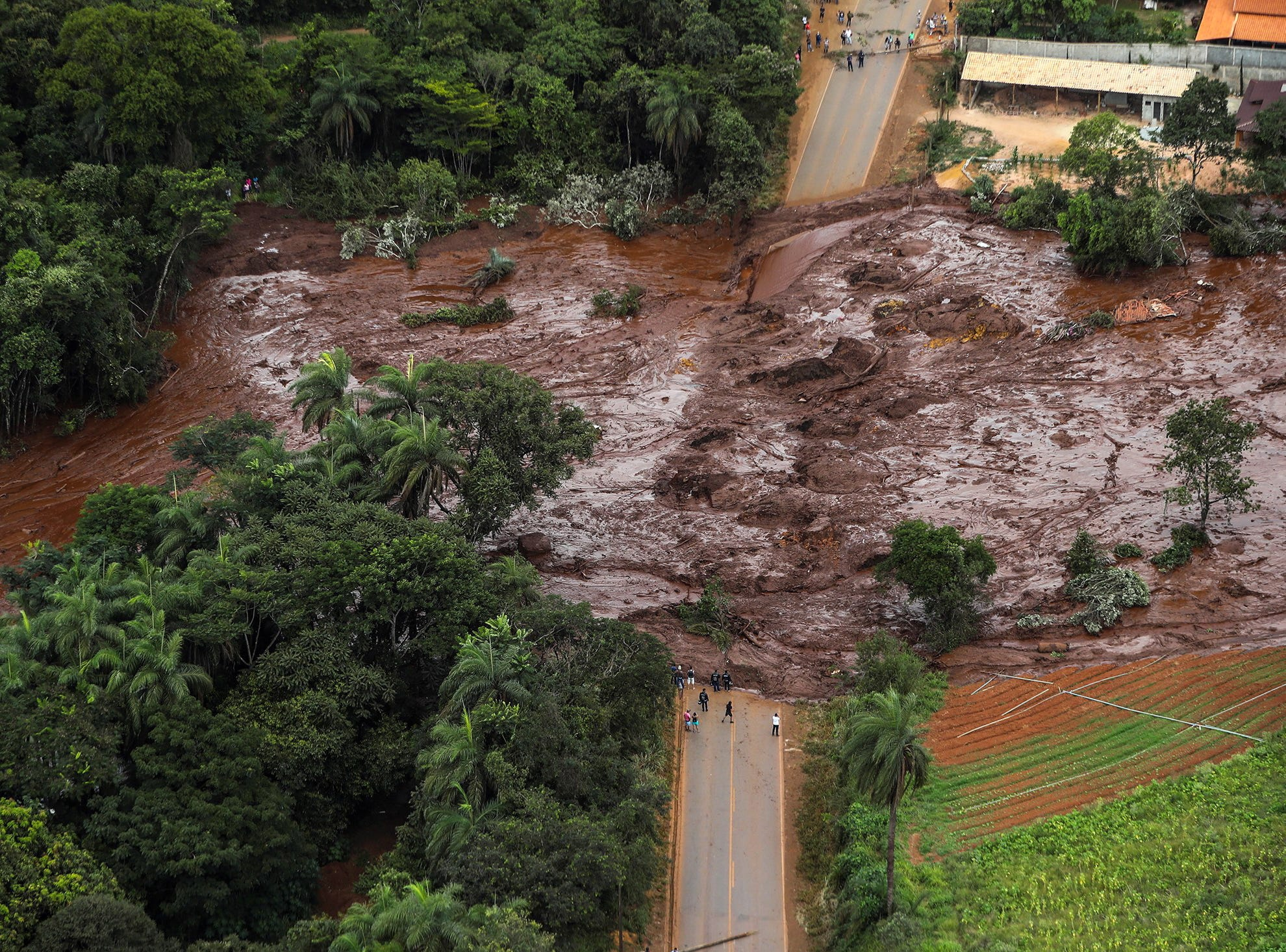 Mud and waste cover a road after a dam spill in Brumadinho, Minas Gerais, Brazil on Jan. 26, 2019. At least nine people have died and 300 are missing after a tailings dam burst at the Feijao mine in southeastern Brazil owned by Vale, the world's largest iron-ore producer, the Minas Gerais state government said. The dam in Brumadinho near Belo Horizonte broke on January 25 at around mid-day, unleashing a river of sludge that destroyed some nearby houses.
