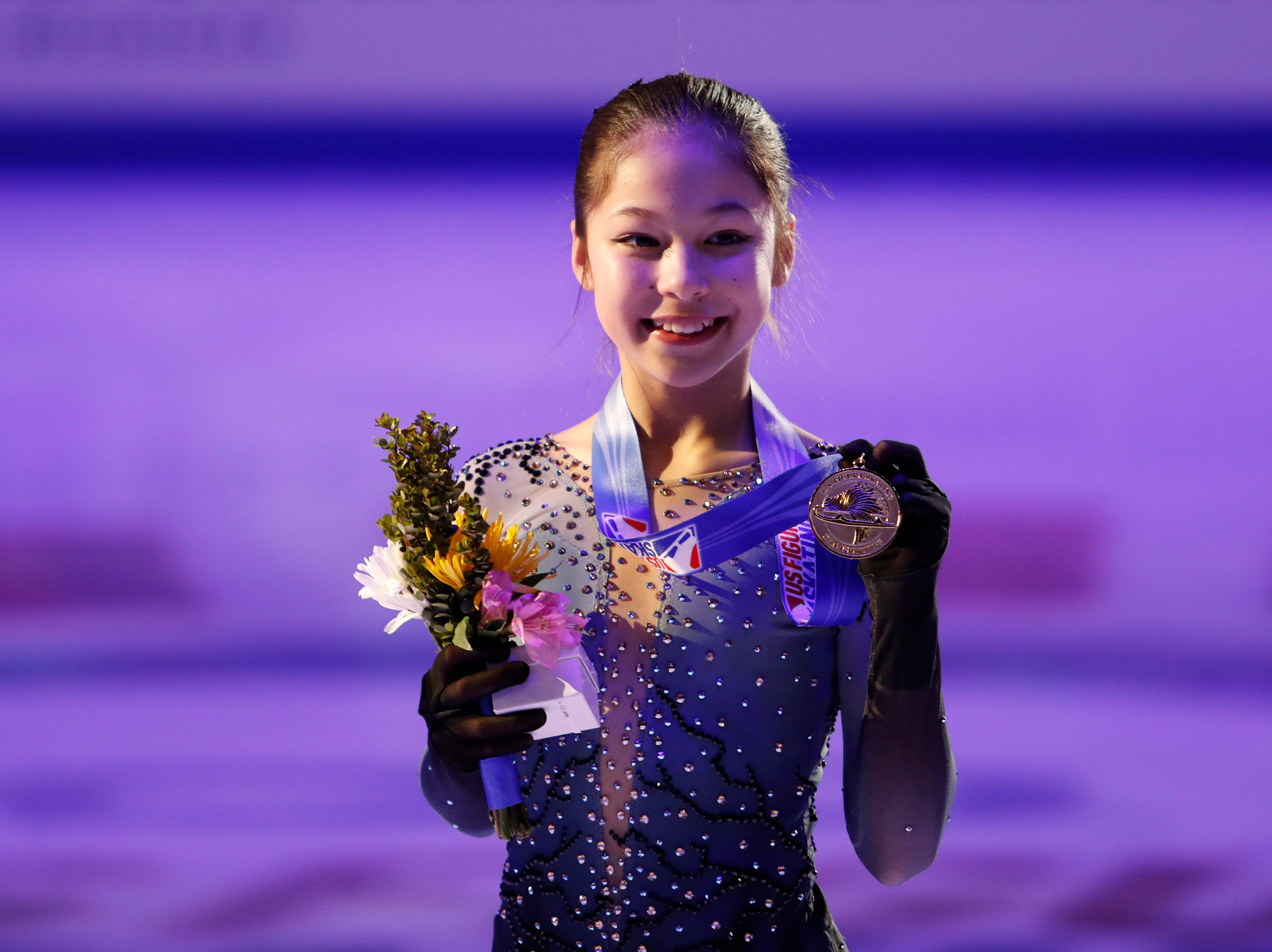 Alysa Liu poses with her gold medal after winning the ladies figure skating championship at the 2019 U.S. Figure Skating Championships at Little Caesars Arena.