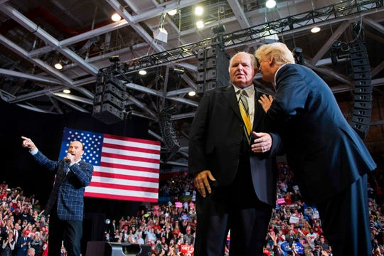Donald Trump speaks to  Rush Limbaugh at a Make America Great Again rally, Cape Girardeau, Missouri, Nov. 5, 2018.
