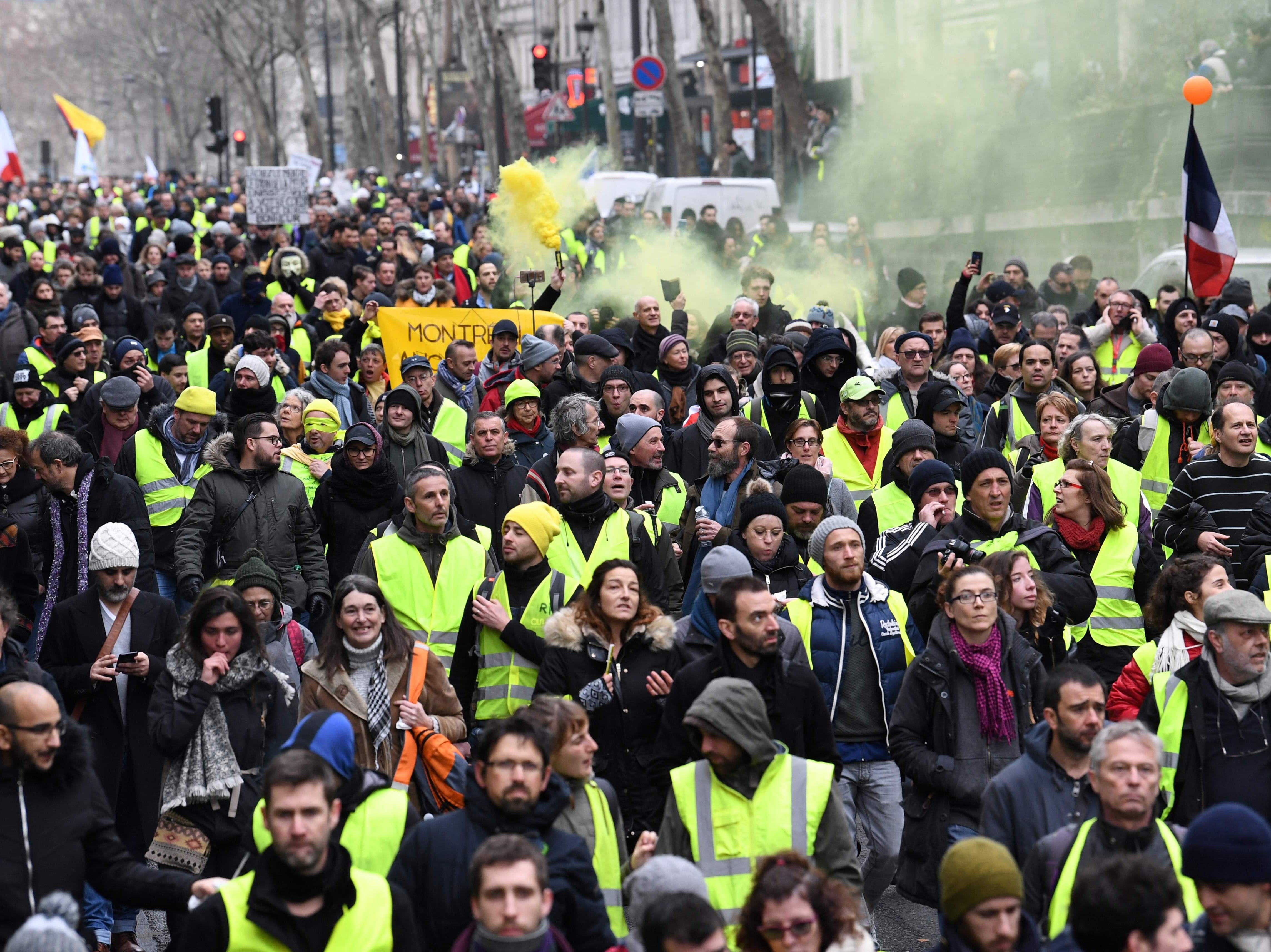 "Protestors take part in an anti-government demonstration called by the Yellow Vests ""Gilets Jaunes"" movement in Paris on Jan. 26, 2019."