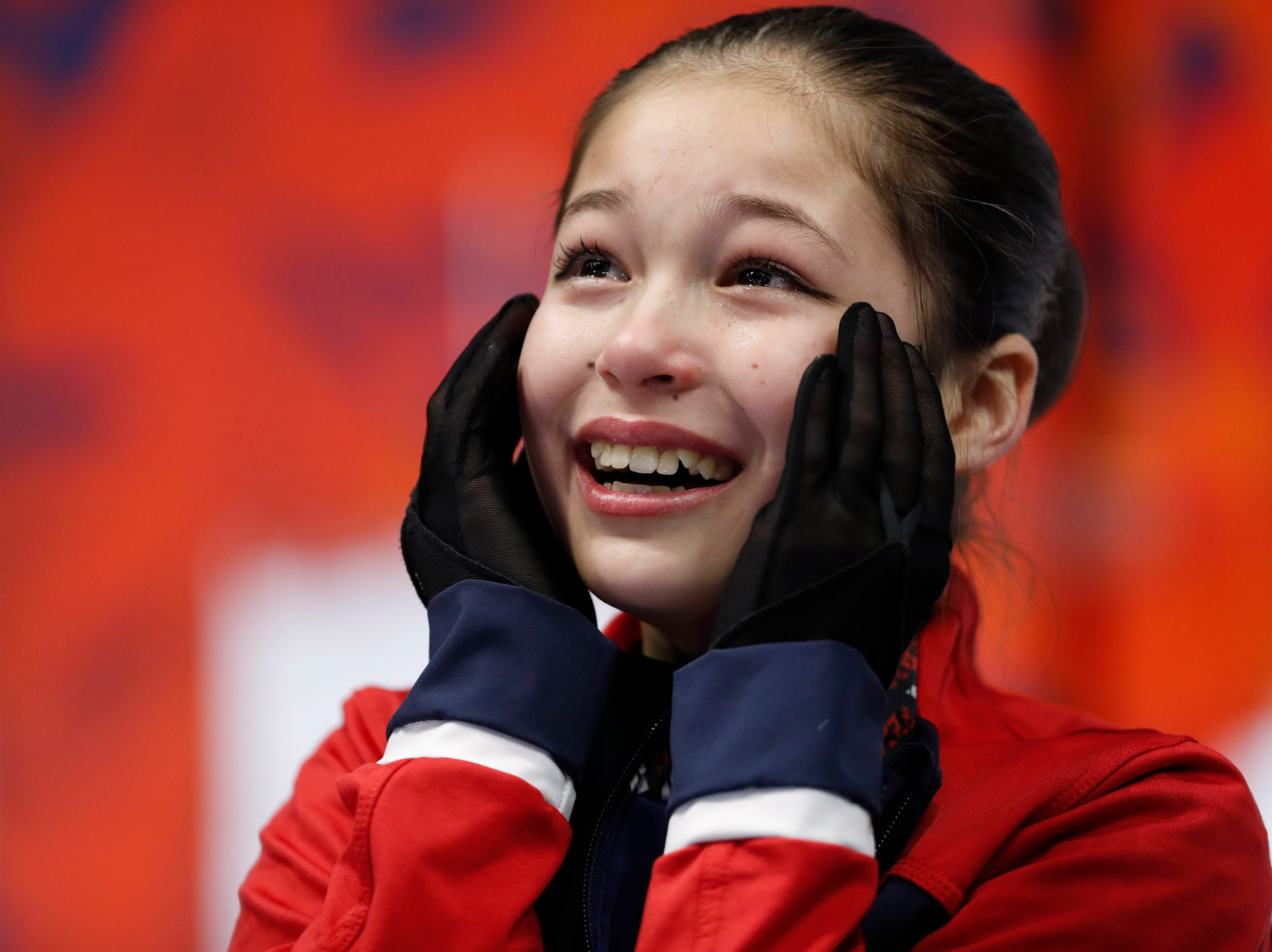 Alysa Liu reacts to her score after her performance in the ladies free skate program.