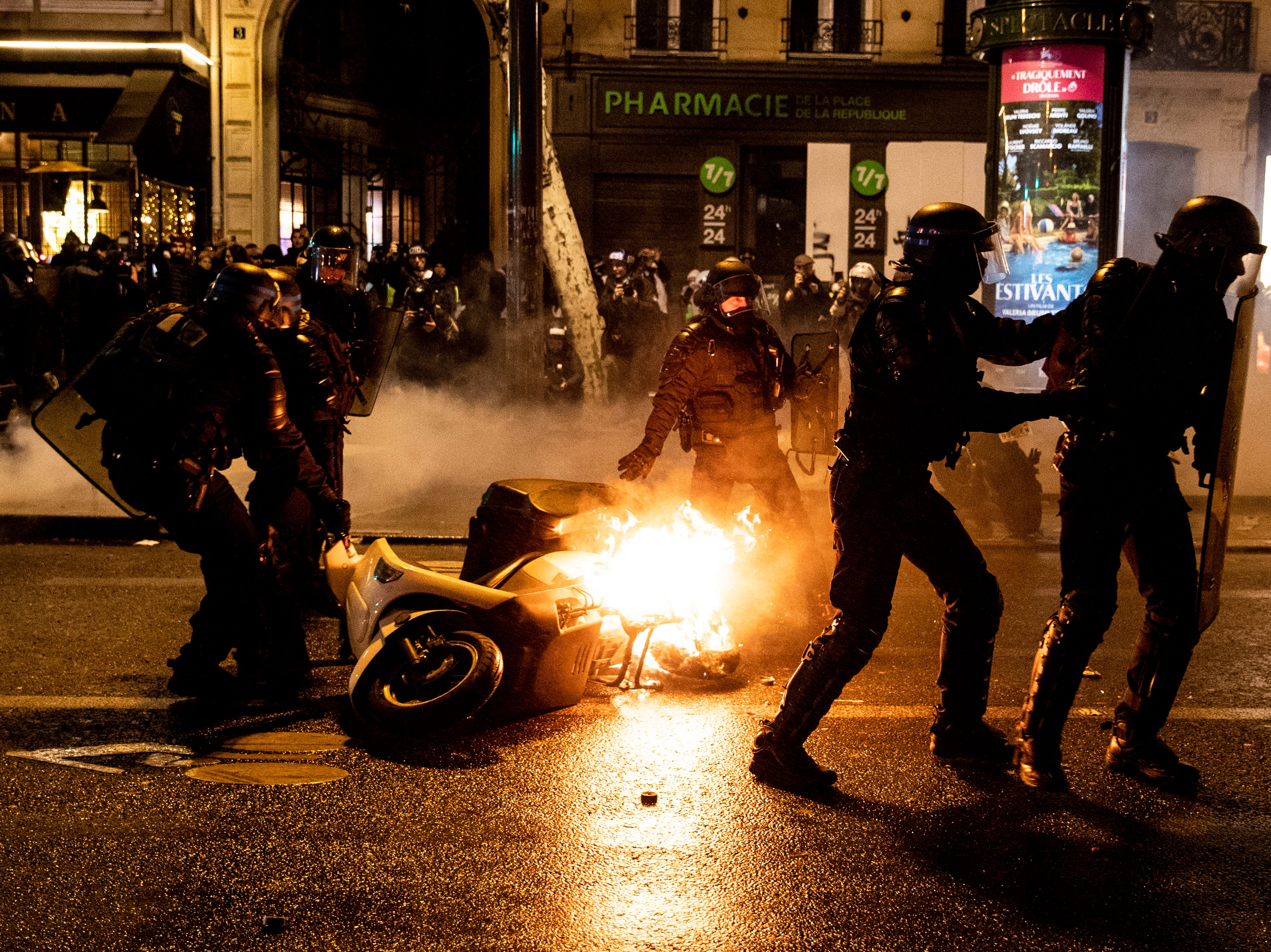 French riot police take away a burning scooter as clashes erupted with 'Gilets Jaunes' (Yellow Vests) protesters who wanted to stay all night on the square during the 'Act XI' demonstration (the 11th consecutive national protest on a Saturday) in Paris, France on Jan. 26, 2019. The so-called 'gilets jaunes' is a grassroots protest movement with supporters from a wide span of the political spectrum, that originally started with protest across the nation in late 2018 against high fuel prices. The movement in the meantime also protests the French government's tax reforms, the increasing costs of living and some even call for the resignation of French President Emmanuel Macron.