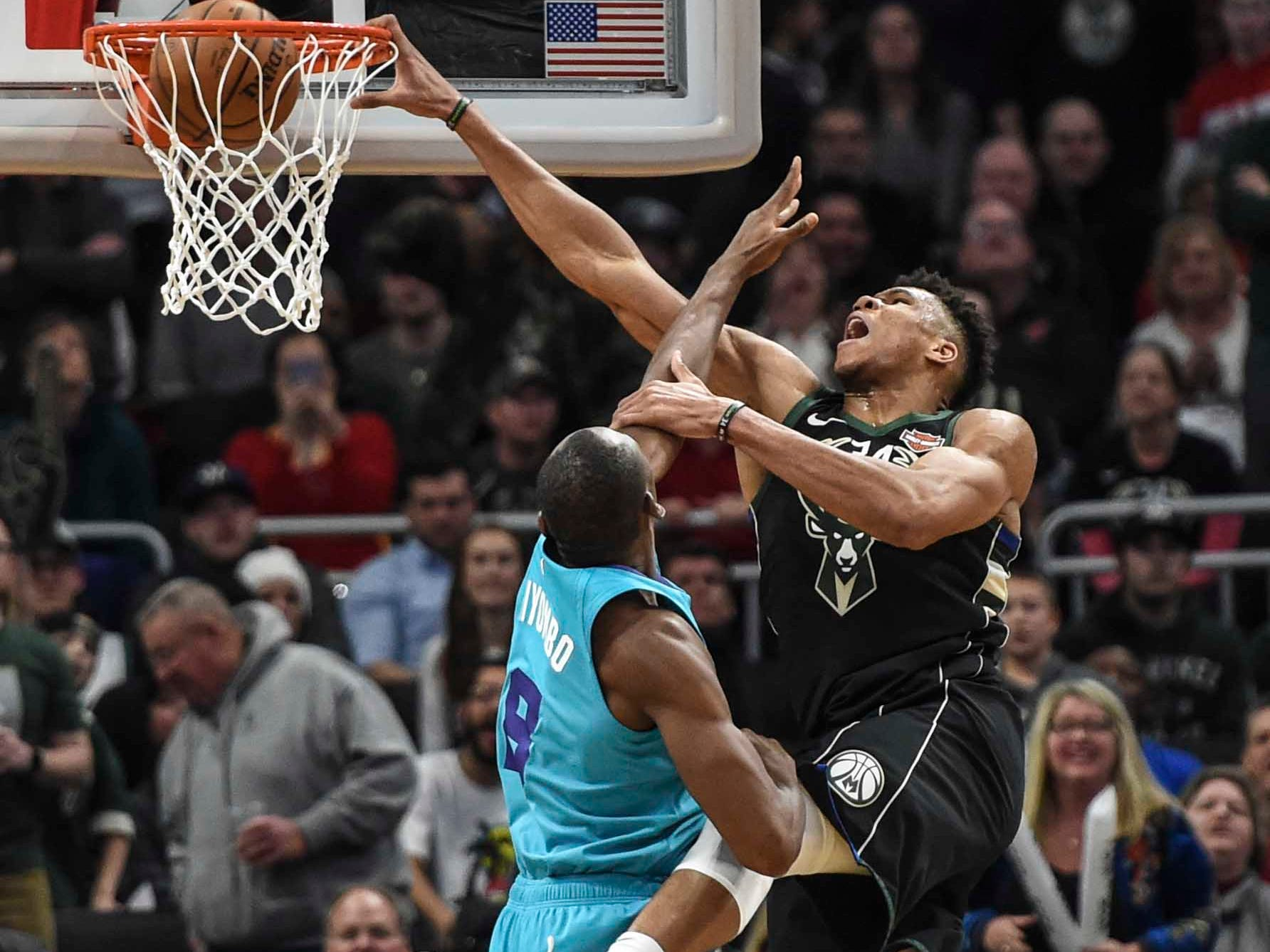 Jan. 25: Bucks forward Giannis Antetokounmpo (34) reaches to finish the one-handed slam over Hornets defender Bismack Biyombo (8) during the second half in Milwaukee.