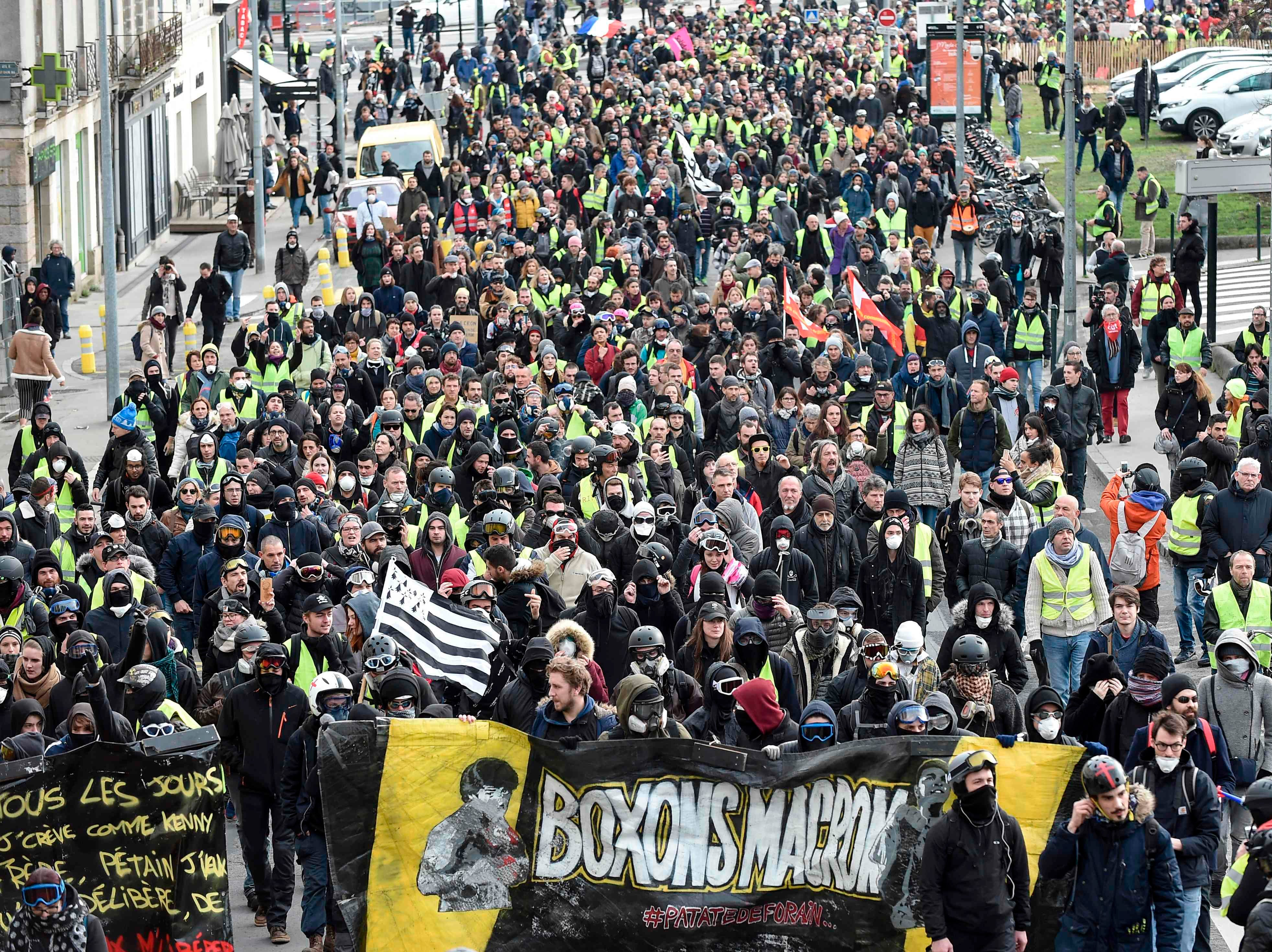 "Protestors march during an anti-government demonstration called by the Yellow Vests ""Gilets Jaunes"" movement in Nantes, western France, on Jan. 26, 2019."