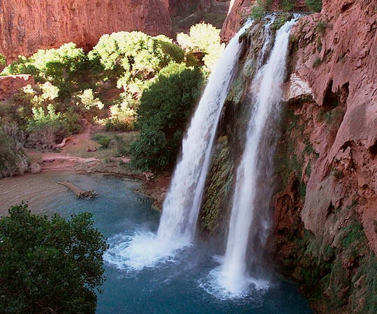 This 1997 file photo shows one of five waterfalls on Havasu Creek as its waters tumble 210 feet on the Havasupai Tribe's reservation in a southeastern branch of the Grand Canyon near Supai, Ariz.