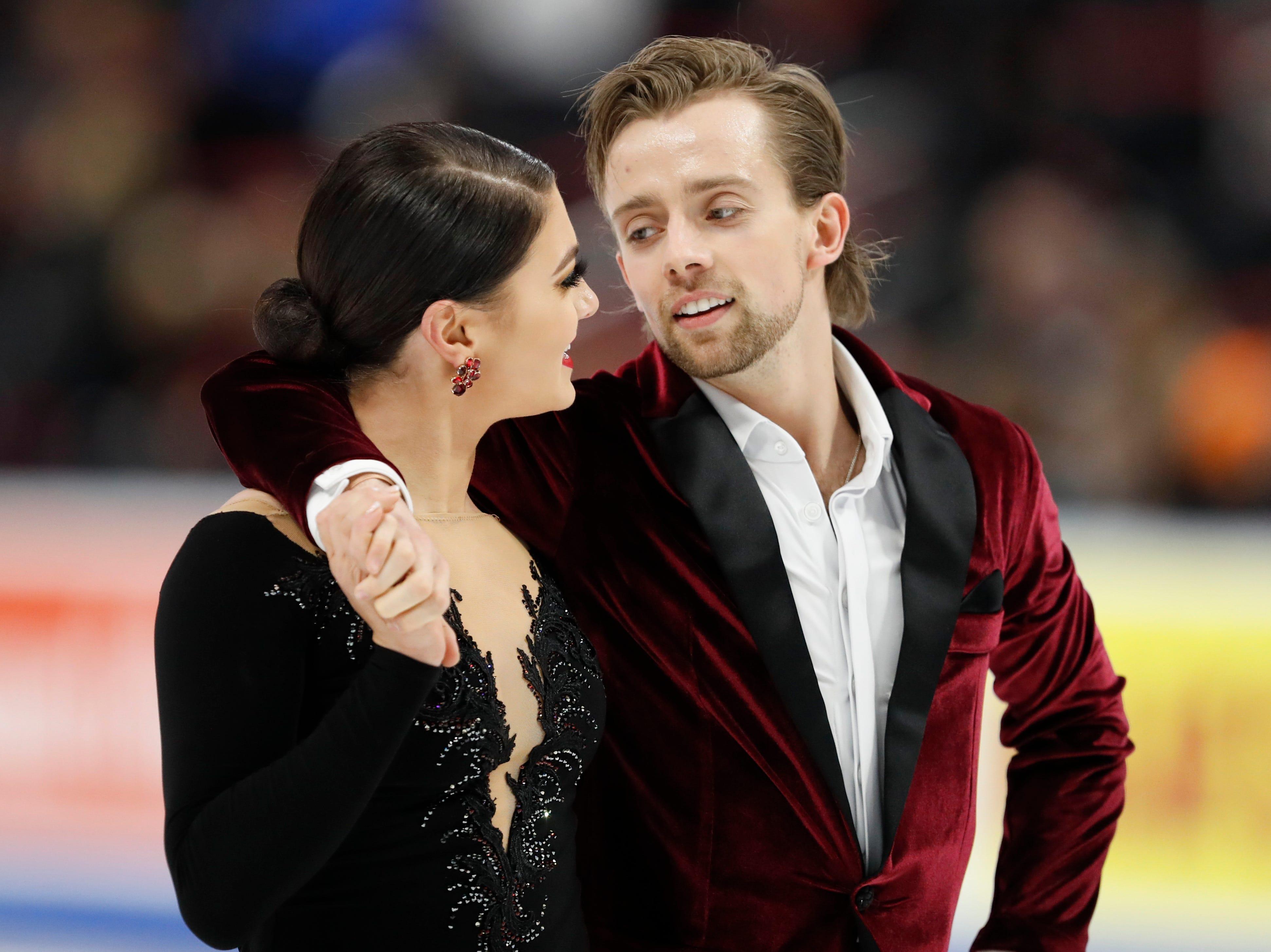 Kaitlin Hawayek and Jean-Luc Baker react after their performance in the rhythm dance program.