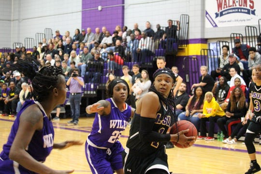 LSUA forward Danyale Bayonne (1) goes up for a shot against Wiley College Saturday.