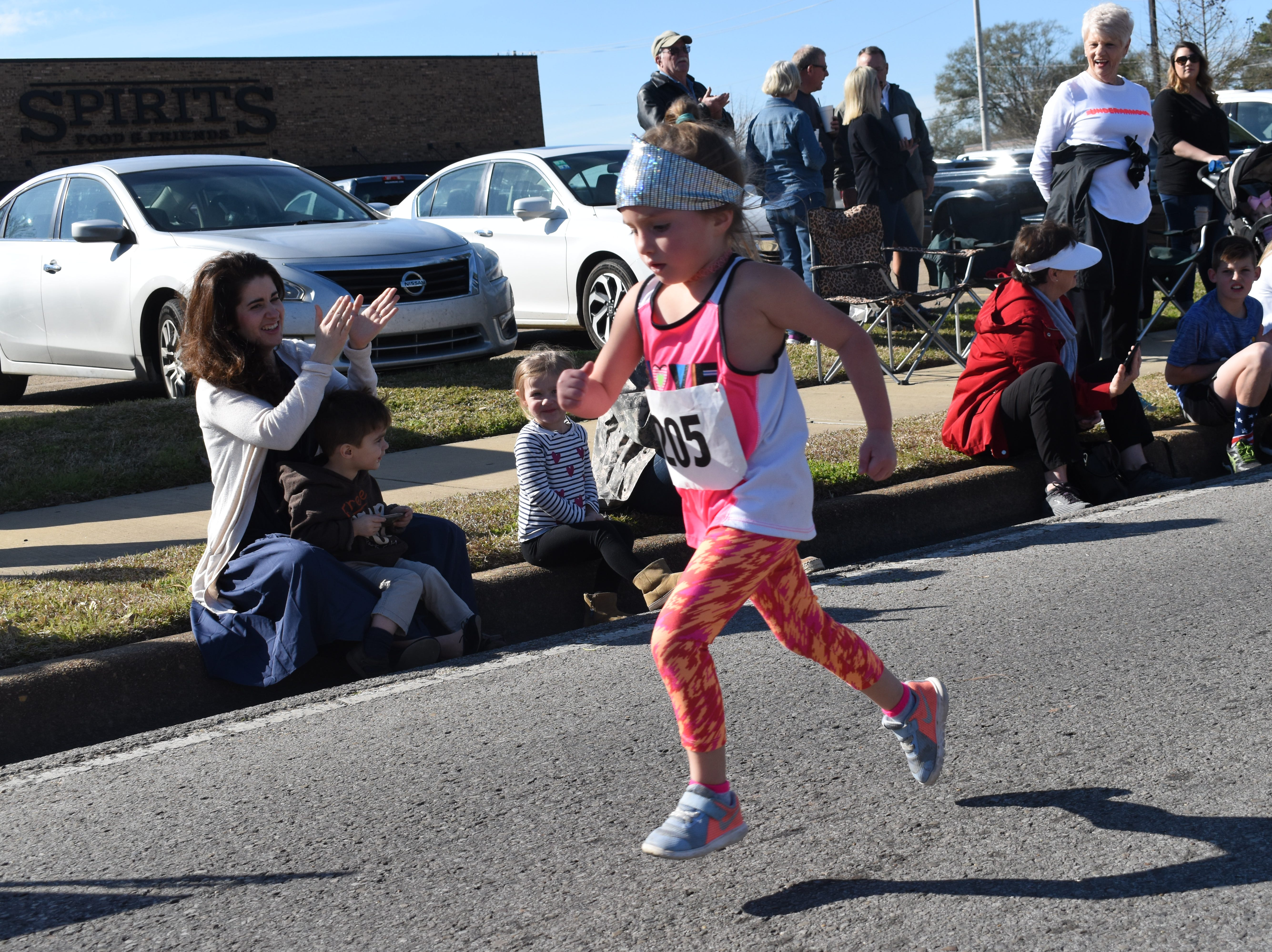 Over 212 runners participated in the 19th annual Spirits 5K and 1-mile Fun Run benefitting the Manna House Saturday, Jan. 26, 2019. About 75 runners participated in a new event held this year - the Beer Run. Runners had to drink four beers and sprint to the finish line. Proceeds from the runs benefit the Manna House which serves free meals year round to anyone who needs a meal regardless of income. Over 200 people a day are fed. The Manna House opened in 1990 and was the vision of Father Gerad Foley.