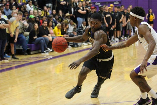LSUA guard JaMichael Brown (23) drives down the lane against Wiley College on Saturday.