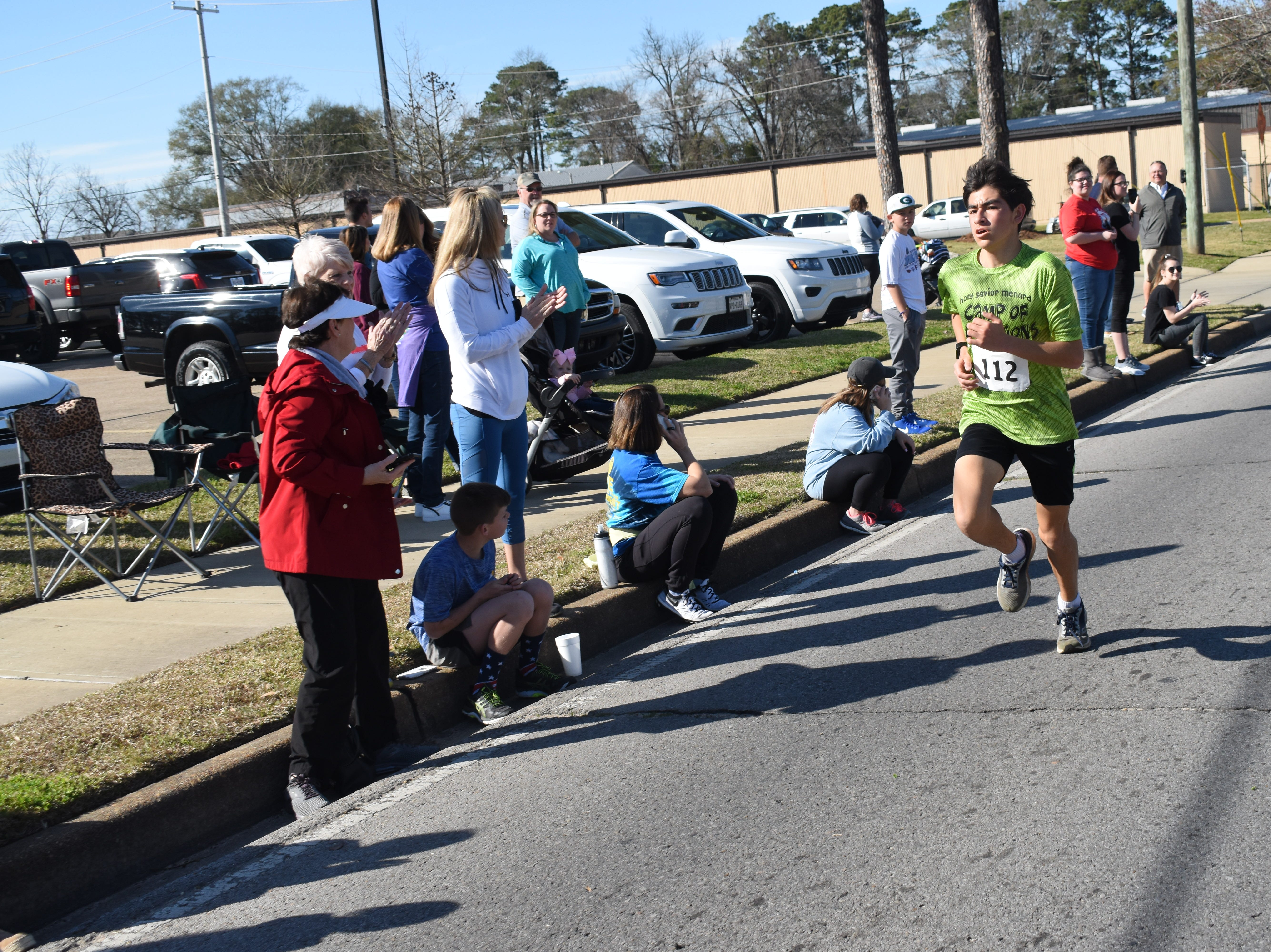 Cyrus Cox, 16, came in second in the 19th annual Spirits 5K with a time of 17:07.3. Over 212 runners participated in the 19th annual Spirits 5K and 1-mile Fun Run benefitting the Manna House Saturday, Jan. 26, 2019. About 75 runners participated in a new event held this year - the Beer Run. Runners had to drink four beers and sprint to the finish line. Proceeds from the runs benefit the Manna House which serves free meals year round to anyone who needs a meal regardless of income. Over 200 people a day are fed. The Manna House opened in 1990 and was the vision of Father Gerad Foley.