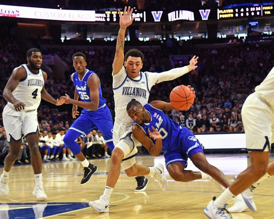 Jan 27, 2019; Philadelphia, PA, USA; Seton Hall Pirates guard Quincy McKnight (0) dribbles the ball around Villanova Wildcats guard Jahvon Quinerly (1) during the first half at Wells Fargo Center. Mandatory Credit: Eric Hartline-USA TODAY Sports