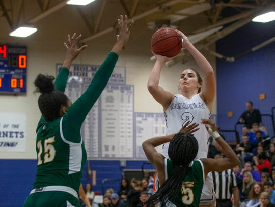 Manasquan's Lola Mullaney goes up with shot in first half action. Manasquan Girls Basketball vs The Patrick School in Coaches Choice USA Basketball in Holmdel NJ on January 27, 2019.