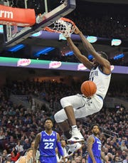 Villanova Wildcats forward Dhamir Cosby-Roundtree (21) dunks against the Seton Hall Pirates during the second half at Wells Fargo Center.