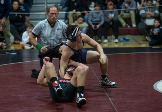 Howell's Paul Jakub vs Jackson Memorial's Carsten Digiantomasso in 152 lbs final of Shore Conference Individual Wrestling Championships.