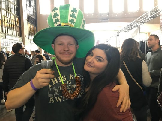 Dylan Morgan, 25, of Howell and Valeria Mezzina, 27, of Roselle celebrate at the Asbury Park Beerfest.