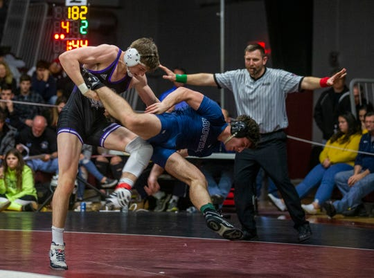 Rumson-Fair Haven's Nick Addison (left) defeated Howell's Christian Murphy 11-4 in the 182-pound championship match of the Shore Conference Wrestling Tournament.