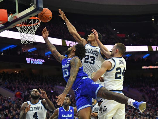 Seton Hall Pirates guard Myles Powell (13) drives to the basket past Villanova Wildcats forward Jermaine Samuels (23) and guard Joe Cremo (24) during the first half at Wells Fargo Center.