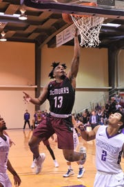 McMurry's Zacc Carter (13) tries to lay the ball in against Hardin-Simmons at the Mabee Complex on Saturday, Jan. 26, 2019. The War Hawks won 75-70.