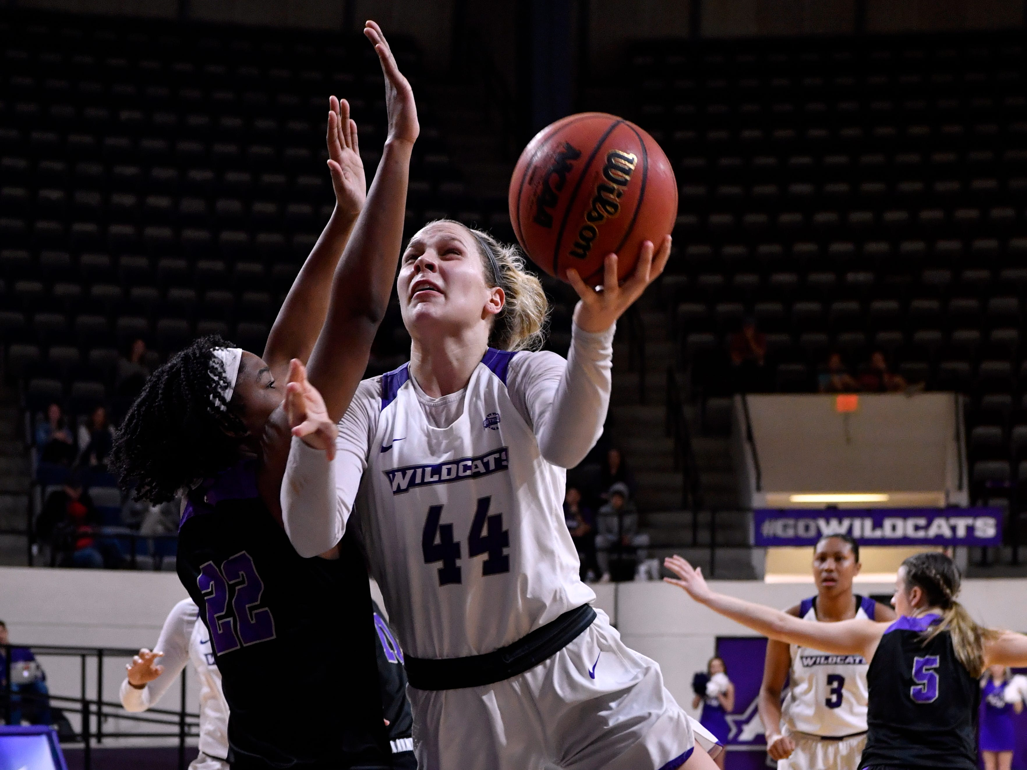 Lexie Ducat tries shooting around Central Arkansas' Alana Canady as she goes to the basket during Abilene Christian University's women's basketball game against Central Arkansas Saturday Jan. 26, 2019. Final score was 77-70, ACU.