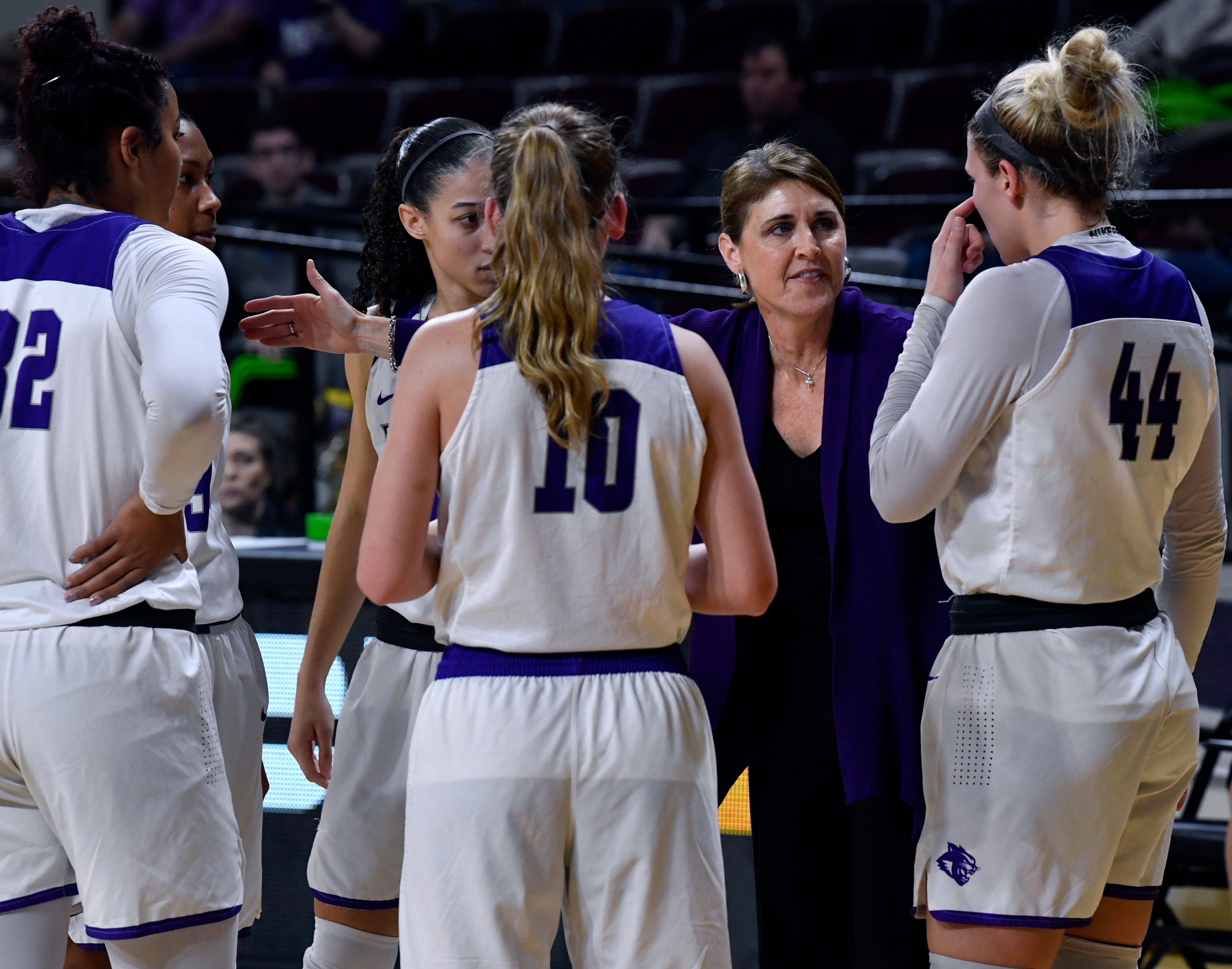 ACU coach Julie Goodenough talks to her players during the Wildcats game against Central Arkansas on Jan. 26 at Moody Coliseum. ACU beat the Sugar Bears 77-70.